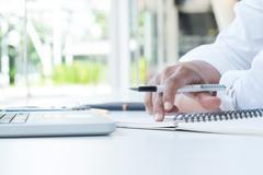 Businessman working in office analyze business marketing data . Kuvituskuvat