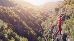 Brave Young Man Balancing On Rope Above Mountains Tree Nature Adventure Stock Footage