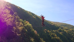 Low Angle Shot Of Man Balancing On Rope Against Sky Slacklining Mountain Extreme Stock Footage
