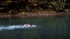 Hardening in cold water. Man bathes in the lake autumn Stock Footage