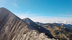 Sporty Young Man Climbing Mountain Edge Sunny Hiking Drone Rock Adventure Travel Stock Footage