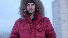 Man in a winter jacket Stock Footage