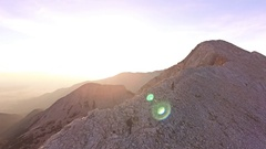 Drone Footage Of Man And Woman Trekking On Mountain Sunny Hiking Adventure Stock Footage