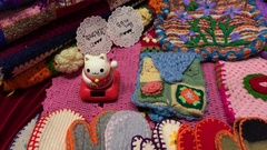 Wool gloves and maneki neko on the shelves at the flea market : 4K footage Stock Footage