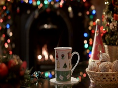 Pouring boiling water into a teacup on a background of a burning fireplace Stock Footage