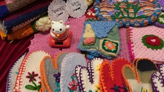 Pan right shot of colorful wool gloves on the shelves at the flea market : 4K Stock Footage