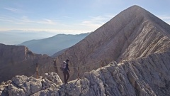 Young Man Hiking On Edge Of Mountain Cliff Extreme Sport Climbing Drone Stock Footage