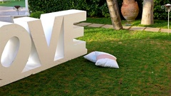Garden decorated for a wedding party, big word Love in the center Stock Footage