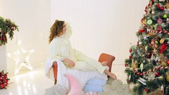 Girl having fun in their pajamas near the Christmas tree Stock Footage