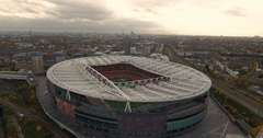 Aerial push out view of the Arsenal football stadium in North London Stock Footage