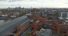 Aerial push out view of St Pancras station and the national library Stock Footage