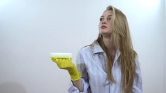 Young Sexy Woman Cleaning Apartment - portrait on white background Stock Footage