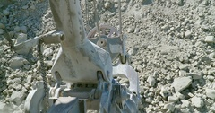 4K Digging and extraction of ore with big machine in a opencast mine Stock Footage