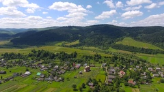 Aerial shoot of the houses and the vilage. Aerial fly over shoot of the village Stock Footage