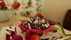 Dragon fruit with chocolate. Tropical dessert Stock Footage