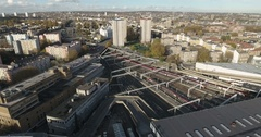 Aerial push out view of St Pancras station in London with trains running Stock Footage