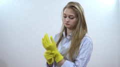 Young Sexy Woman wearing yellow rubber gloves - portrait on white background Stock Footage