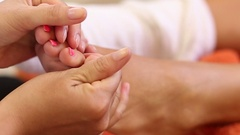 Woman receiving a foot massage at the health spa Stock Footage