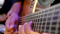Man playing guitar with a band, close up Stock Footage