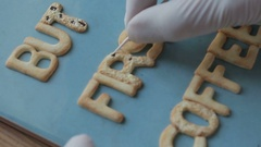 Artist makes jewelry from color Polymer Clay, artist at work Stock Footage