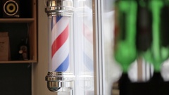 Barber Pole Spinning at a Barbershop. Stock Footage