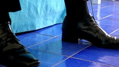 Man putting on his elegant patent leather shoes Stock Footage