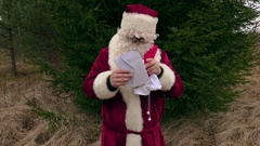 Santa Claus checking letters Stock Footage