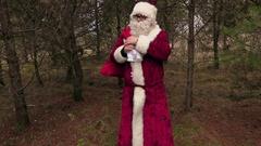 Santa Claus take gift bag on shoulder walking away Stock Footage