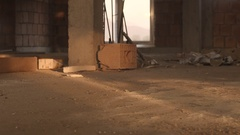 Man falls dead to the ground in an abandoned facility Stock Footage