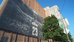 CLEVELAND, DOWNTOWN, LARGE LEBRON JAMES MURAL, CLOSE UP WITH TREE Stock Footage