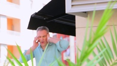 Man talking on the phone in a noisy street Stock Footage