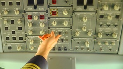 Pilot pressing button on the control panel of plane before takeoff Stock Footage