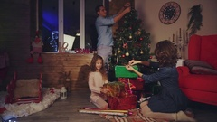 Family decorate the house for Christmas, New Year scene Stock Footage
