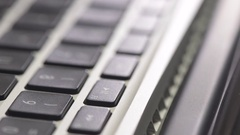 Computer keyboard in close up. Film clip with sliding motion of office work. Stock Footage