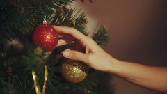 Woman hands play with ball on christmas tree close up Stock Footage