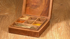 Collection of Indian spices in wooden box with bay leaves Stock Footage