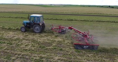 Amazing top view of a tractor working a grass field in Po Valley Stock Footage