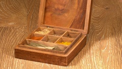 Collection of Indian spices in wooden box with fenugreek Stock Footage
