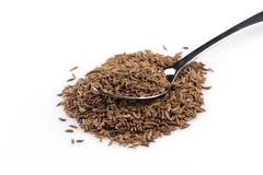 Heap of dry caraway seeds Stock Photos