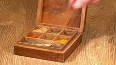 Collection of Indian spices in wooden box with cinnamon bark Stock Footage