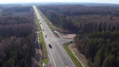 Aerial view of a truck and other traffic driving along a road Stock Footage