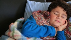Portrait of a sick child feeling cold Stock Footage