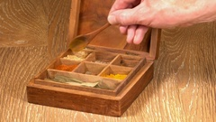 Collection of Indian spices in wooden box with ginger Stock Footage