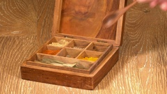 Collection of Indian spices in wooden box with Turmeric Stock Footage