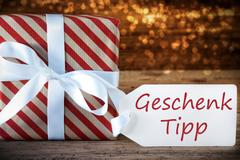 Atmospheric Christmas Present With Label, Geschenk Tipp Means Gift Tip Stock Photos
