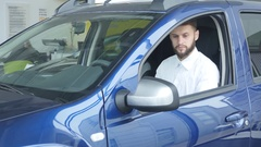 Happy customer just bought a car at car dealership Stock Footage