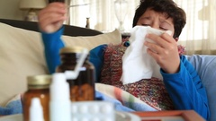 Sick,  tired child sneezing into tissue and resting Stock Footage