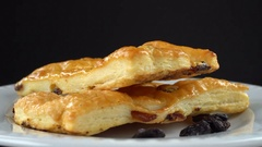 Delicious homemade pastry on a black background. Seamless loopable. Prores 4K Stock Footage