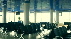 Airport lounge with emty seats and decorated Christmas trees. Holidays travel Stock Footage