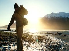 Alaskan Cameraman Walks Back from Coast Sunflare Shoot 2K Stock Footage